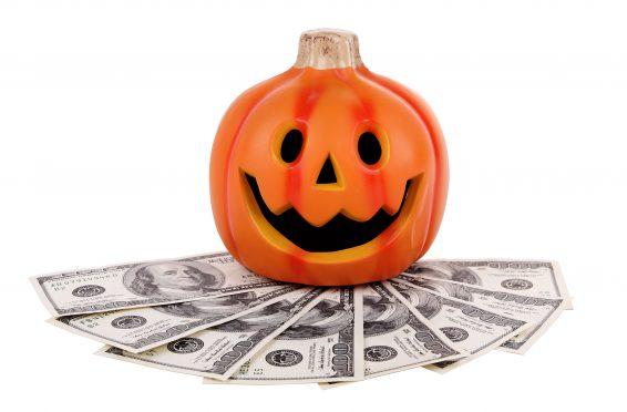 Halloween pumpkin with money.