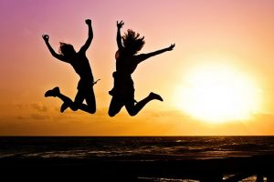 Happy People jumping for joy during a sunset.