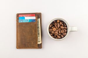 Wallet and a Mug filled with Coffee Beans