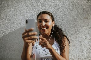 Pretty young girl taking a selfie