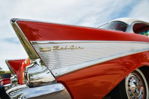 The tail fin of a cherry-red Bel Air.