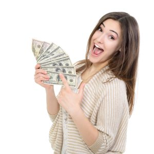 Cheerful attractive young lady holding cash from online title loans and happy smiling over white background.