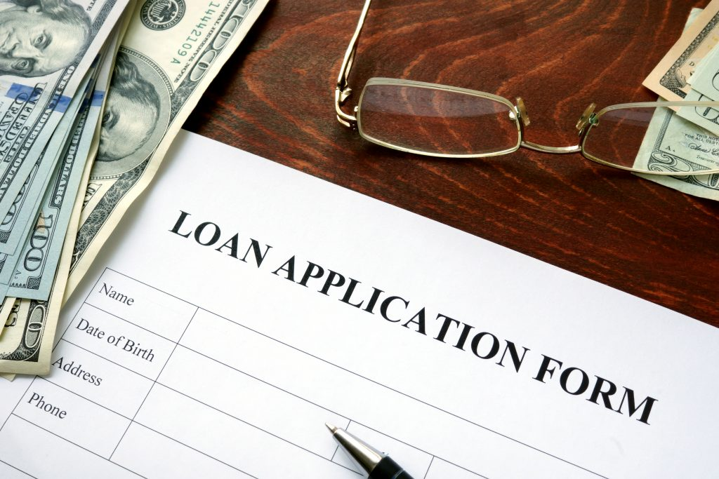 Loan application form on a wooden table.