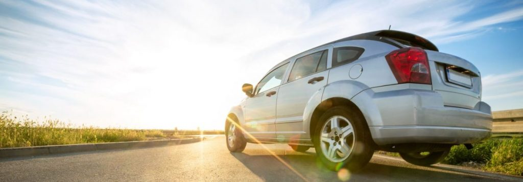 A car drives on the open Texas road. Max Cash Title Loans brokers loans all across the state of Texas.