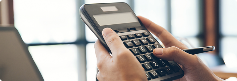 A Person using a Calculator