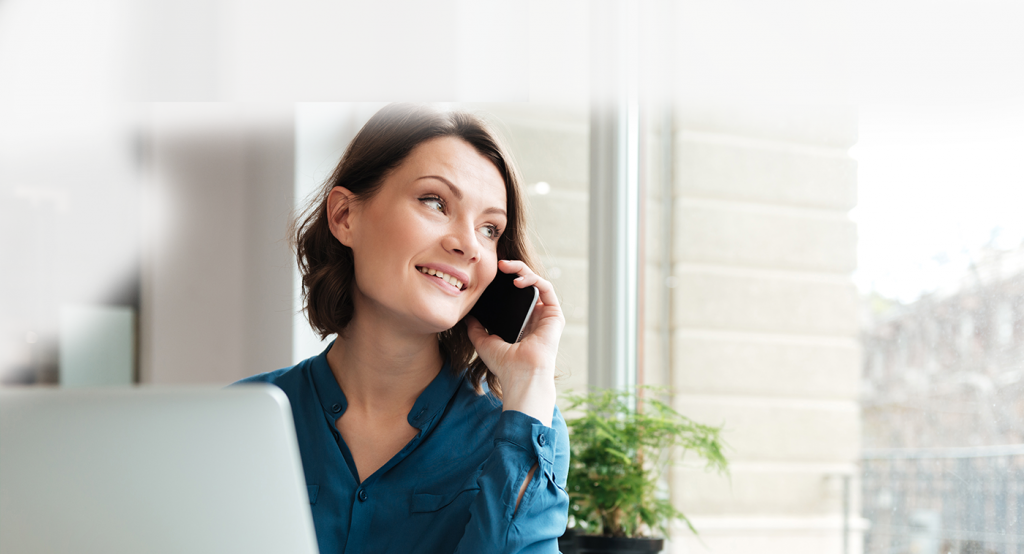 A woman talking happily on phone